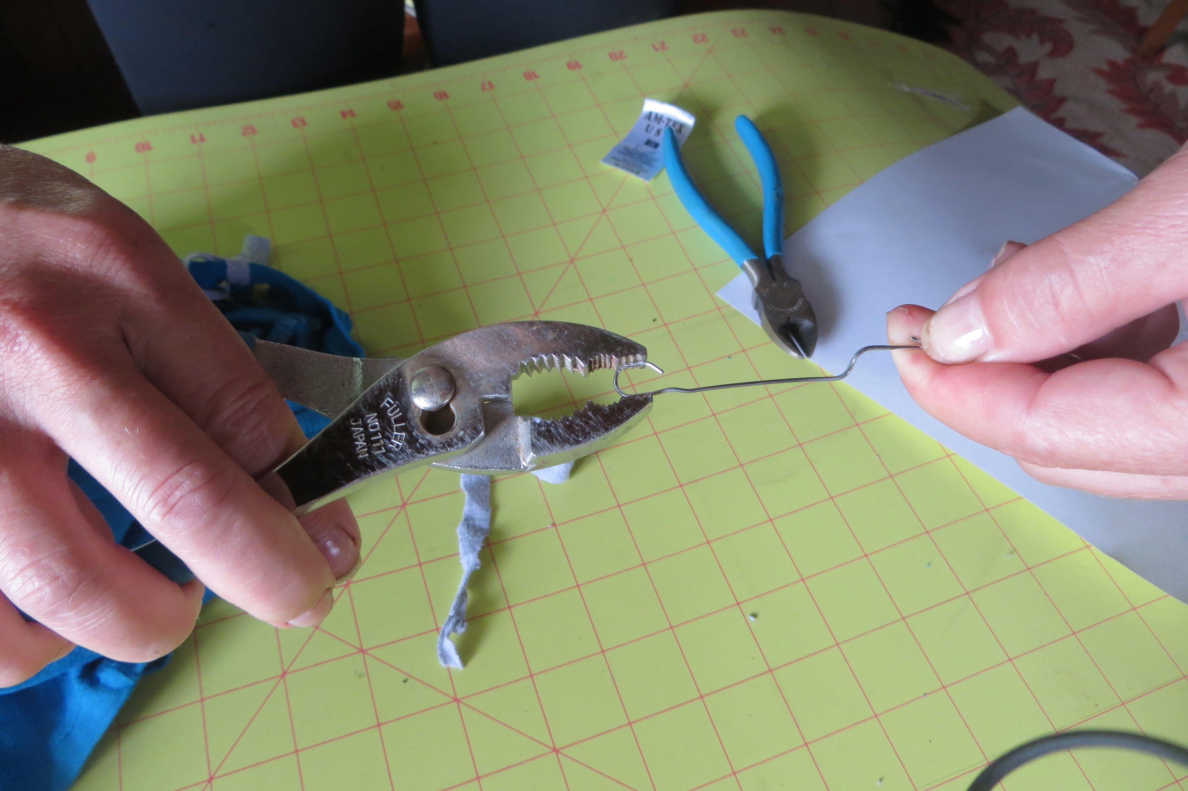 """(A large crochet hook would work well but I didn't have one on hand).  Simply use the hook to """"fish"""" for the cut """"thread"""" in front of your loop  IMG_6585"""