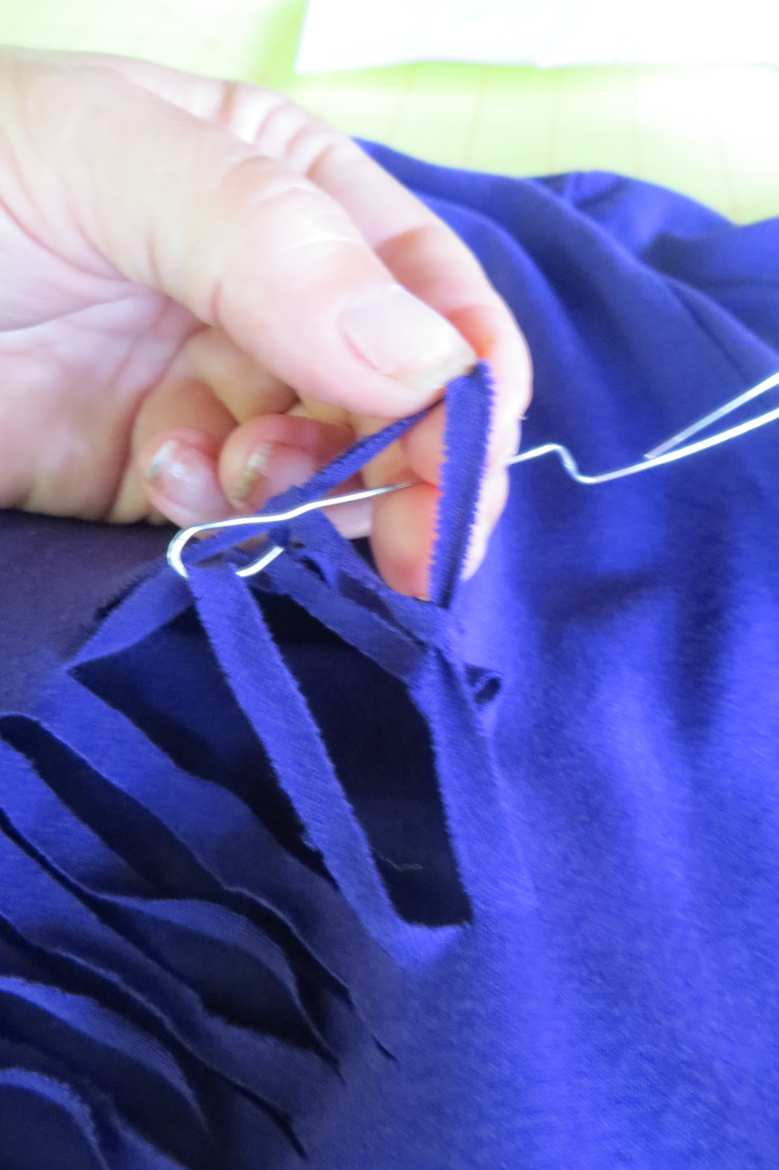 and pull the fished thread through.